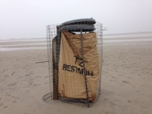 Walking on the beach in the middle of nowhere - a solitary bin for 'Restmüll'!